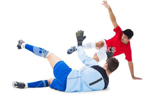 Football player striking at goalkeeper
