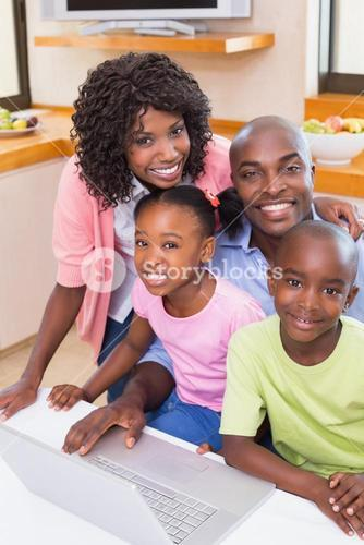 Happy family using the laptop together
