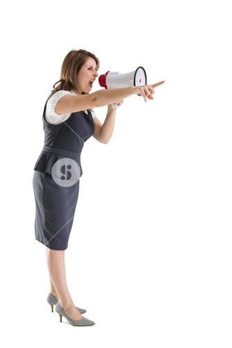 Young woman shouting into bullhorn as she gestures