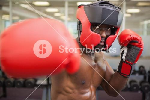 Male boxer attacking with his right