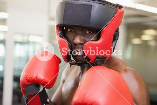 Male boxer in defensive stance