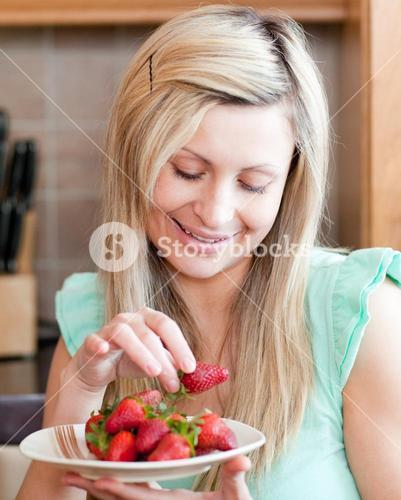 Positive woman eating fruits