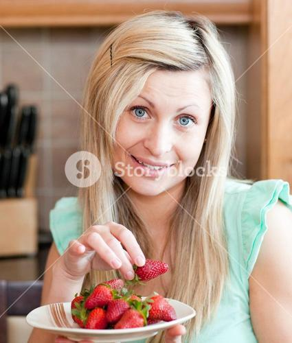Cute woman eating fruits