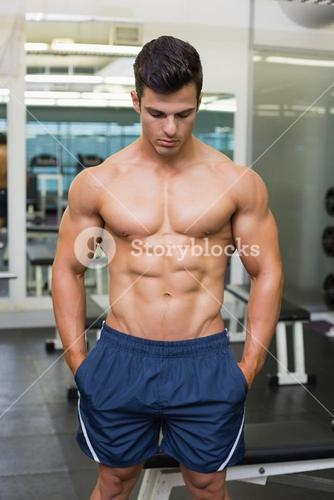 Muscular man looking down