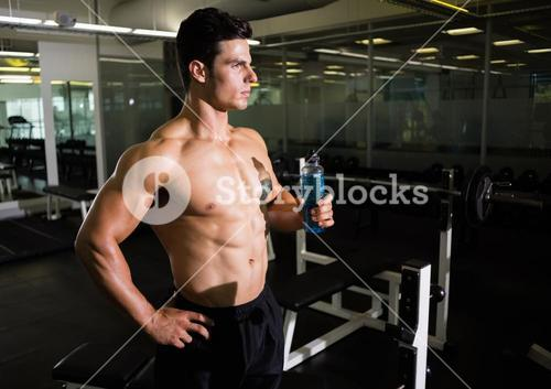 Muscular man holding energy drink