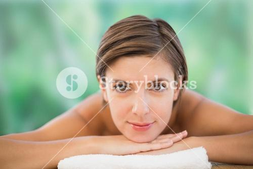 Beautiful woman on massage table at health farm