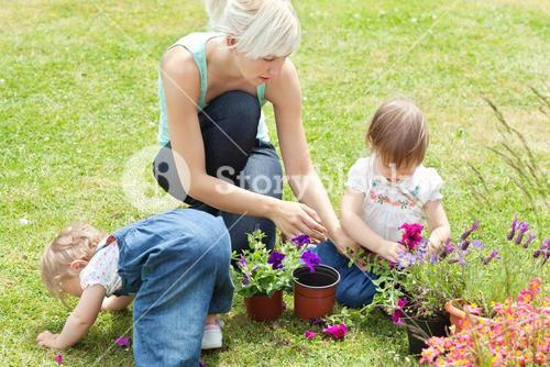 Family in the garden with flowers