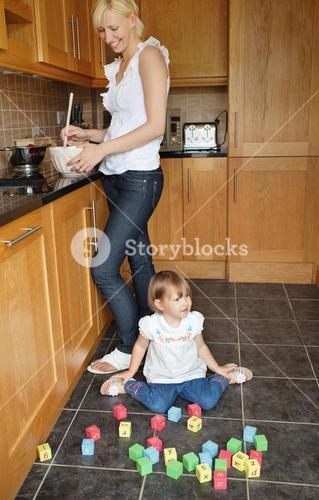 Smiling mother playing child