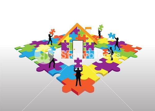 Business people standing on jigsaw puzzle building house