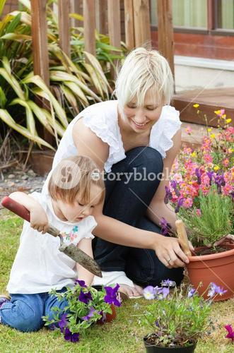Delighted mother with her daughter outside