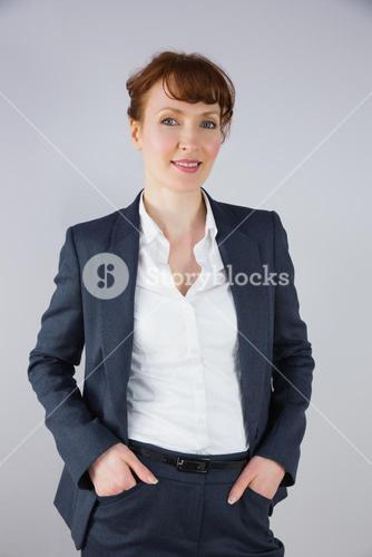 Businesswoman in suit smiling at camera