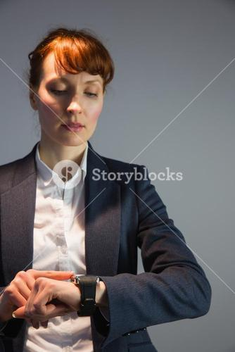 Businesswoman in suit checking the time