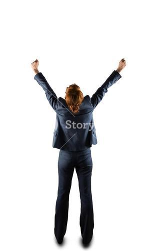 Sucessful businesswoman in suit cheering