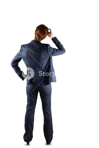 Businesswoman in suit scratching head