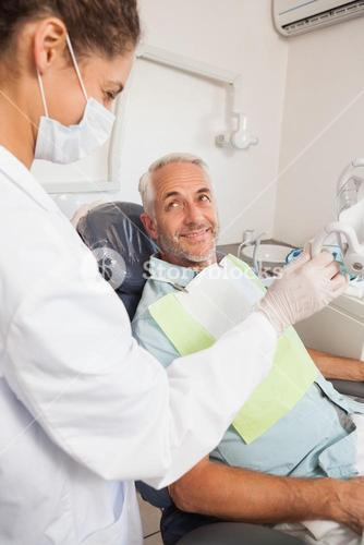 Patient smiling at dentist in the chair