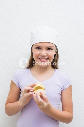 Little girl holding model teeth