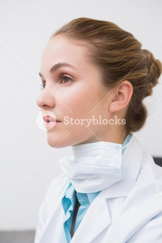 Dentist with surgical mask thinking