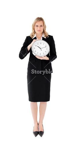Unhappy businesswoman against white background holding a clock