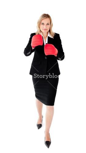 Ambitious businesswoman boxing wearing a black suit