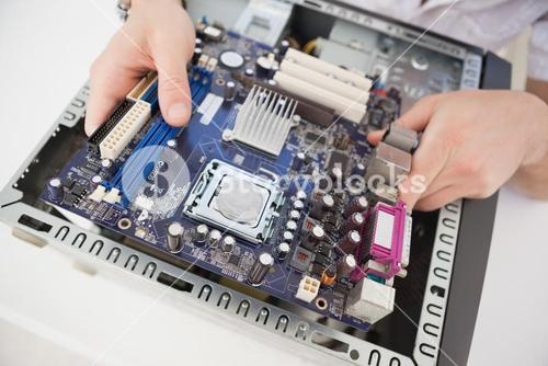 Computer engineer working on broken cpu