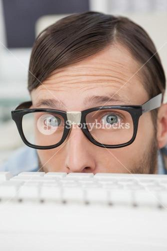 Nerdy businessman working on computer