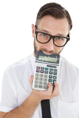 Nerdy excited businessman biting calculator