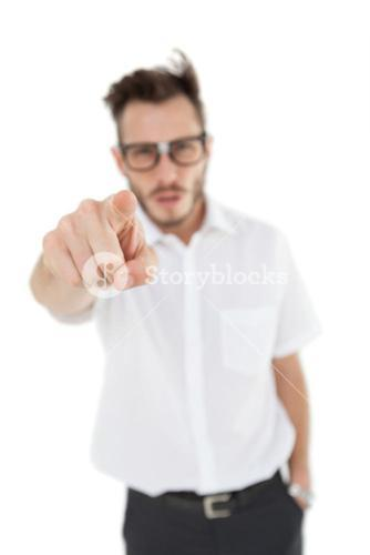 Nerdy businessman pointing at camera