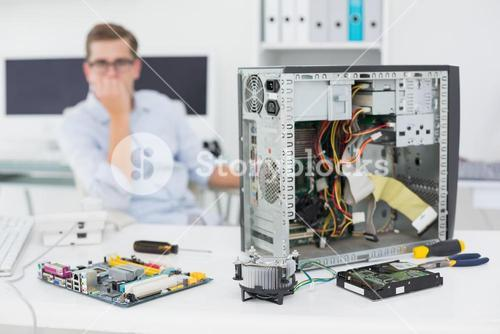 Computer engineer looking at broken console
