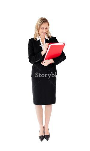Radiant businesswoman writing on a paper against white background