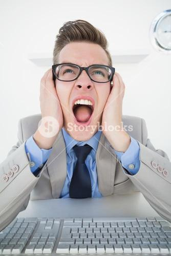 Angry businessman working on computer