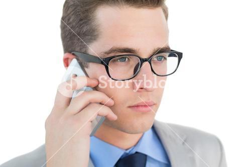 Nerdy businessman talking on phone