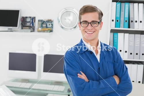 Smiling technician looking at camera