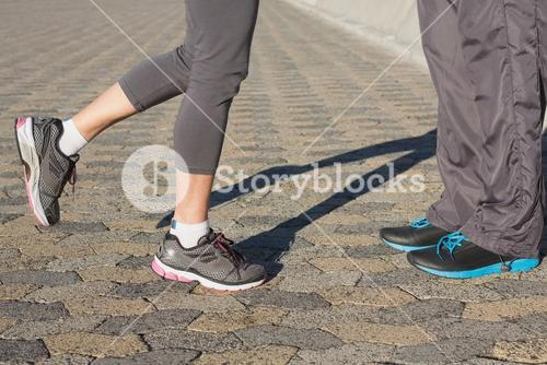 Couple in running shoes facing each other