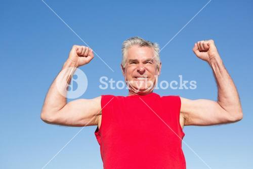 Active senior man cheering in red tank top