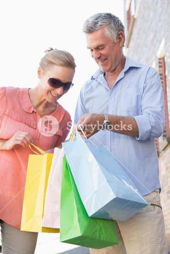Happy senior couple looking at their purchases