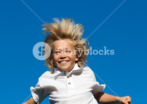 Young Kid Jumping in the air outdoor
