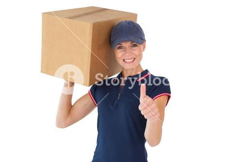 Happy delivery woman holding cardboard box showing thumbs up