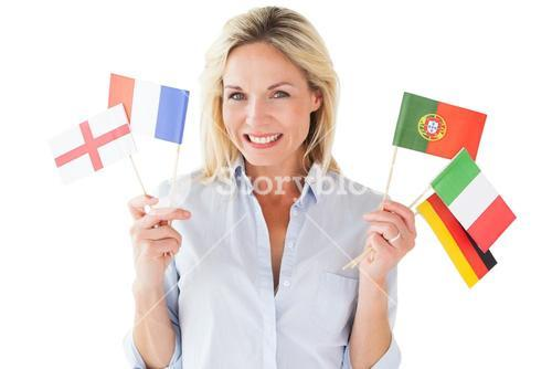 Smiling blonde woman holding european flags