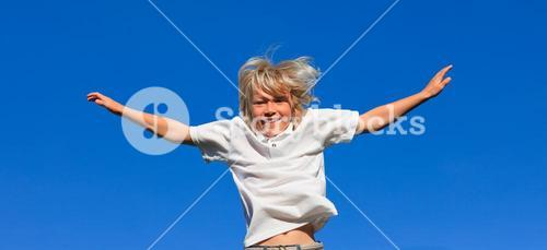 Cute Kid Jumping in the air outdoor