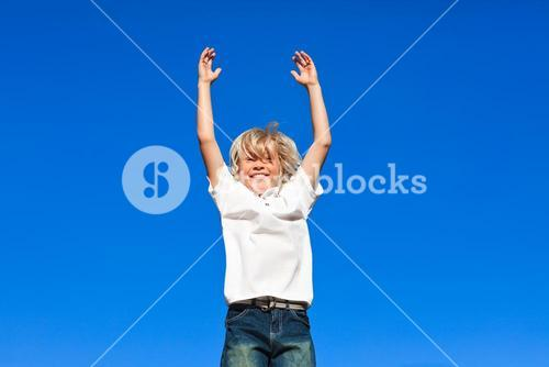 Positive Kid Jumping in the air outdoor