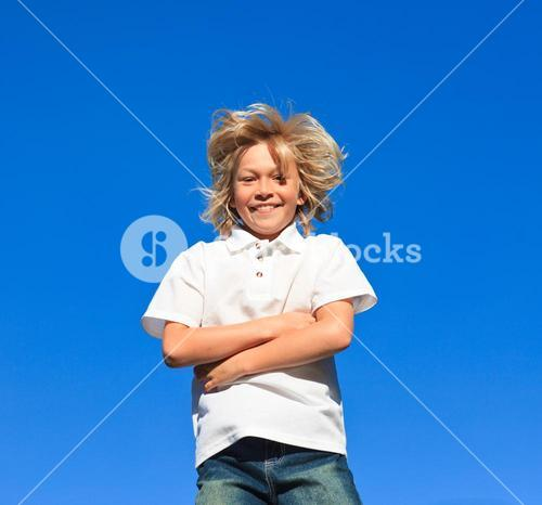 Young Kid with arms folded having fun outdoor
