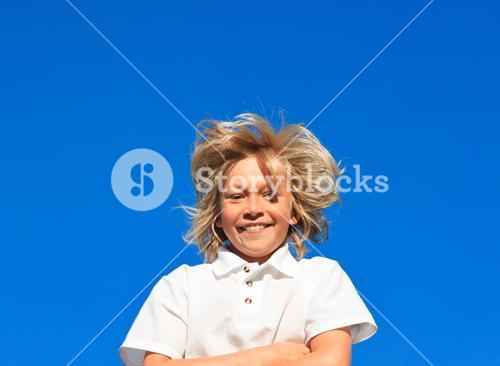 Smiling Kid with arms folded having fun outdoor