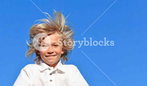 Positive Kid with arms folded having fun outdoor