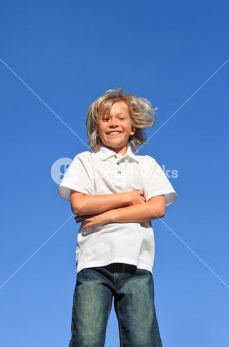Confident Kid with arms folded having fun outdoor