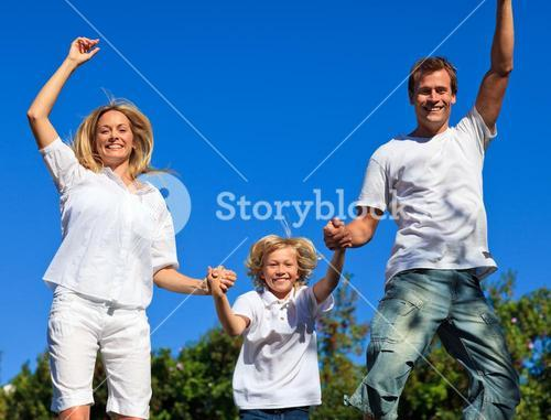 Beautiful family playing in the garden