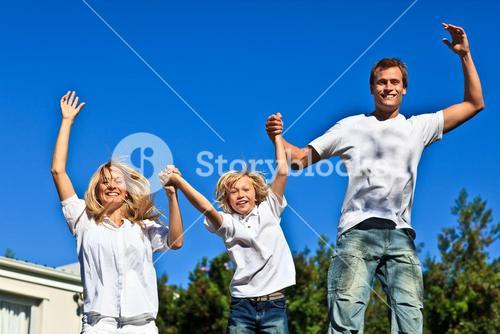 Smiling family playing in the garden