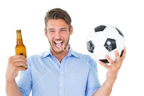Handsome young man holding ball and beer
