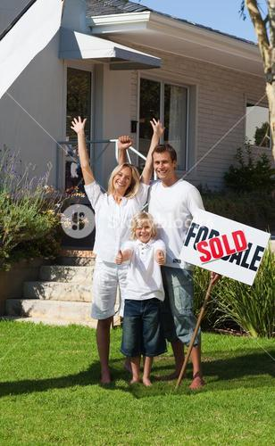 Glowing family after buying a new house