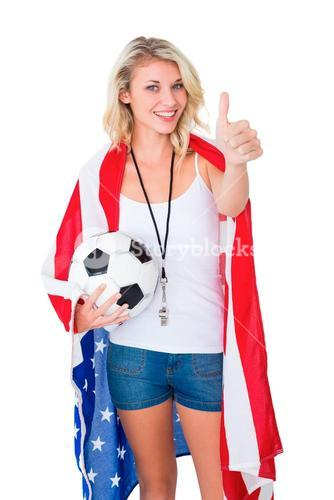 Pretty blonde football fan wearing usa flag showing thumbs up