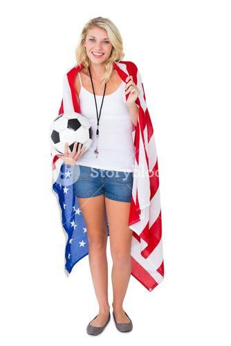 Pretty blonde football fan wearing usa flag
